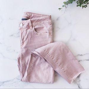 AMERICAN EAGLE • dusty pink raw hem skinny jeans